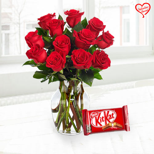 Exclusive Red Dutch Roses in vase with Cadburys Ch... to Raipur