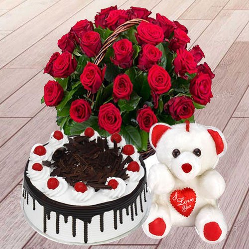 25 Red Roses with 1 Lbs. Black Forest Cake and a T... to Aligarh