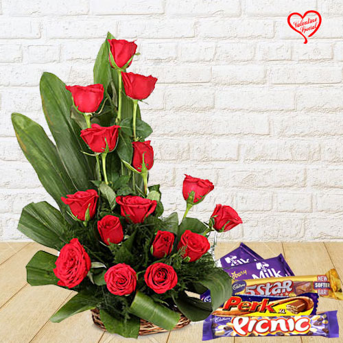 15 Exclusive Red Dutch Roses Basket with Cadburys Assorted Chocolates to Amalampuram