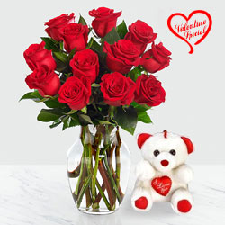 12 Dutch Red Roses in Vase with a Cute Teddy Bear  to Yamunanagar