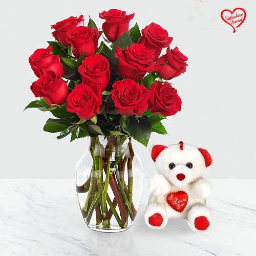 12 Dutch Red Roses in Vase with a Cute Teddy Bear  to Amalampuram