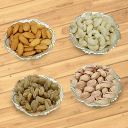 Pleasurable fiesta with mouth-watering Dry Fruits and Silver plated bowls to Barh