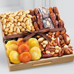 Special Snacks time Dry Fruits in a Wooden Tray to Adugodi