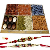Festooned Treat Dry Fruit and Chocolate Platter with Two Rakhis and Roli Tilak Chawal to Cochin