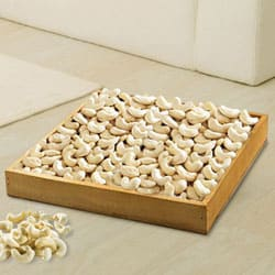 Enticing Cashews in Wooden Tray to Ancharakandy