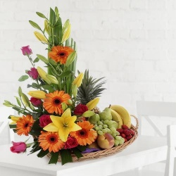 A beautifully arranged fruit and flower basket for dear mom to Hyderabad