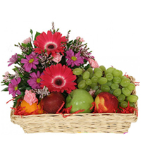 Resplendent colourful Flowers including luscious fresh Fruit basket to Bellary