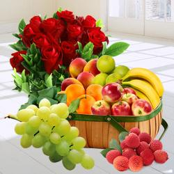 Bright Decadence Souvenir of Fresh Fruits in a Basket nd a Bouquet of Red Roses to Akola