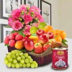 Basket of Fresh Fruits and Haldiram Rasgulla with Pink Rose Bouquet for your Mummy to Bolpur