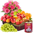 Refreshing Fresh Fruits Collection with Haldiram Rasgulla and Rose Bouquet to Guwahati
