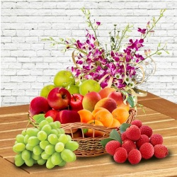 Mothers Day special Fresh Fruits Basket decorated with Orchids to Chennai