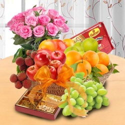 Special Basket of Fresh Fruits, Sweets and Pink Rose Bouquet for your Mummy to Chennai