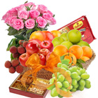 Scrumptious Fresh Fruit Basket with Haldiram Soan Papdi and Rose Bouquet to Bangalore