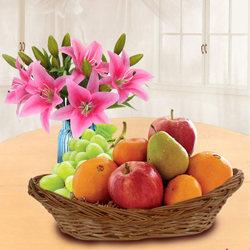 Tasty Fresh Fruits Basket with Pink Lilies to Ariyalur