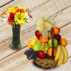 Marvelous Fresh Fruits Basket with Gerberas to Ariyalur