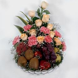 Memorable Gift Combo of Exotic Fruits with Flowers in Glass Vase to Adilabad