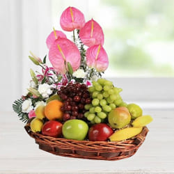 Classically-Styled Fruits Basket decorated with Anthodium, Lily n Carnations to Akola