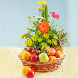 Tantalizing Fresh Fruits with Gerberas Gift Basket to Adilabad