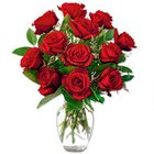 Glorious one dozen Red Roses along with a Vase to Thane
