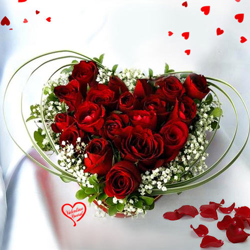 12 Dutch Red Roses in Heart Shape Arrangement to Behrampur