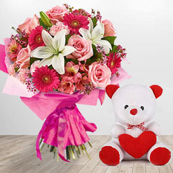Magnificent Flower bouquet along with a cute Teddy Bear gift to India