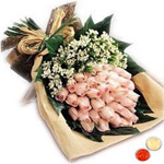 Attractive bouquet of 30 blushing peach or Pink Roses with free Roli Tilak and Chawal to Anand