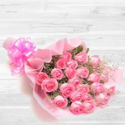 Attractive bouquet of 30 blushing peach or Pink Roses to Bangalore