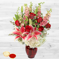 Gorgeous arrangement of fresh Lilies with free Roli Tilak and Chawal to Adilabad