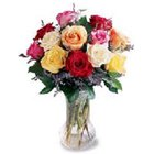 Attractive one dozen of colorful Roses along with a Vase to Calcutta