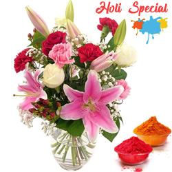 Exquisite special arrangement of fresh Lilies, Roses and Carnations to Ariyalur