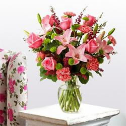 Exquisite special arrangement of fresh Lilies, Roses and Carnations  to Allahabad