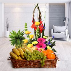 Splendid mixed Flowers including delicious fresh Fruits to Noida