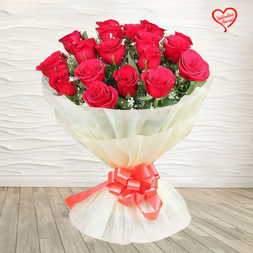 Red Dutch Roses Bouquet Nicely Wrapped to Amalampuram