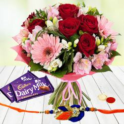 Convivial Blossom Medley with 2 Dairy Milk Chocolate with Rakhi and Roli Tilak Chawal to Ajmer