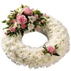 Wreath of White Carnation with Pink Rose to Bangalore
