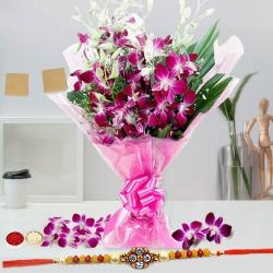 Vibrant Blooms of Orchid Stems Bouquet With Rakhi to Amalampuram
