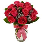 Attention-Getting Red Roses in a Glass Vase to Amalampuram