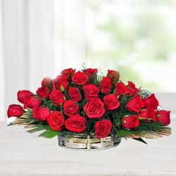 Cheerful Assortment of Red Roses with Fillers in a Basket to India
