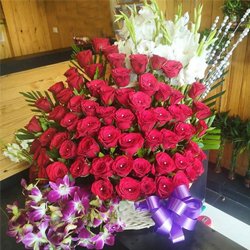 Wonderful Arrangement of Roses, Orchids N Tube Roses to Amalampuram