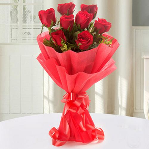Graceful Bunch of Red Roses with Tissue Wrap to Aluva