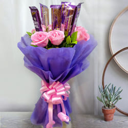 Delightful Bouquet of Pink Roses with Cadbury Dairy Milk to Akola