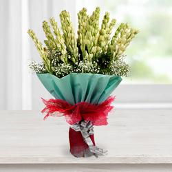 Exquisite Hand Bouquet of Tuberoses with Tissue Wrapping to Agra