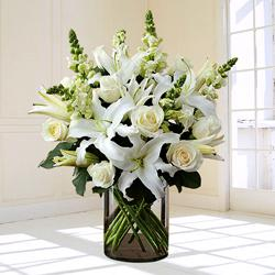 Graceful White Flowers in Glass Vase for Condolence to Ahmedabad