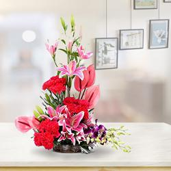 Designer Arrangement of Pink Anthurium with Cala Lilies to Adilabad