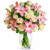Beautiful Arrangement of Pink Lilies & White Roses in a Glass Vase