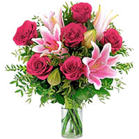 Amazing Pink Lilies N Red Roses Arrangement in Glass Vase