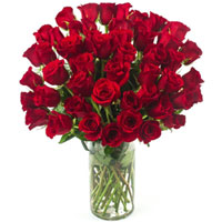 Exotic Red Roses arranged in a Glass Vase