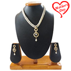 Ravishing Round Stone Studded Pearl Pendent on a Double Line Pearl Necklace with Matching Earrings to Varanasi