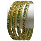 Breathtaking Emerald Studded Golden Bangle Set to Taran Taran
