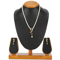 Sizzling Fashion Pearl and AD Pendent Set with Matching Earrings to Aluva